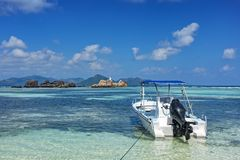 White boat on tropical beach royalty free stock images