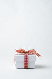 Small White Gift Box with Gingham Checked Ribbon Stock Photo