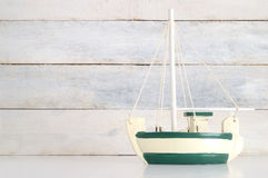 Small white and green wooden boat model Stock Images