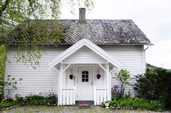 Small Wooden White House with Front Porch - Nordic Stock Photo