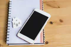 Small White House,Smart Phone and Notebook stock photo
