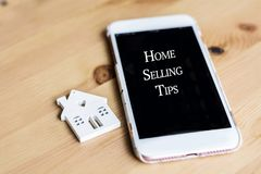 Home Selling Tips Concept with House and Phone. Small White Houses and Smart Phone with Tips for House Selling royalty free stock photos