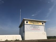 Lifeguard station, Leasowe, Wirral. Small white lifeguard station, Leasowe, Wirral Stock Images