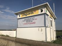 Lifeguard station, Leasowe, Wirral. Small white lifeguard station, Leasowe, Wirral Stock Photography