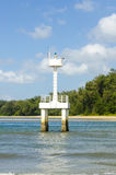 Small white lighthouse lighthouse stands in the sea off the coast of Thailand Stock Images