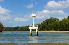 Small white lighthouse lighthouse stands in the sea off the coast of Thailand Royalty Free Stock Photos