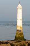 Small white lighthouse Stock Images