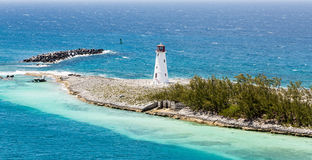Small White Lighthouse on Strip of Land in Caribbean Royalty Free Stock Image