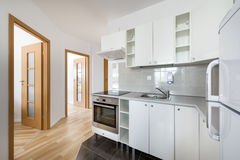 Small, white modern kitchen interior design stock images