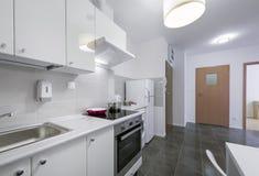 Small, white modern kitchen interior design. In small apartment Stock Photos