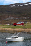 Small white motor boat moored in Norway Stock Photography