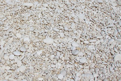 Small white pebbles. On the beach Stock Images