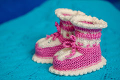 Small white-pink children& x27;s knitted booties Royalty Free Stock Image