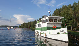 Small white pleasure boat. Moored on Saimaa lake in Finland Stock Images