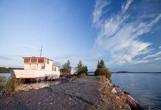 Small white pleasure boat moored on Saimaa lake Royalty Free Stock Images
