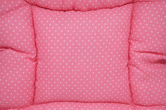 Small white polka dots on pink background fabric Stock Photo