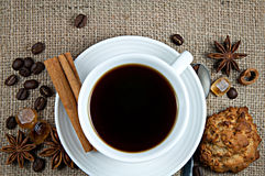 Small white porcelain cup of hot black brewed turkish coffee Royalty Free Stock Photos
