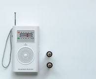 Small White Radio Receiver with two Batteries Stock Photo