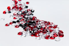 Small white, red and black diamonds stock images