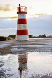 Small white and red lighthouse Stock Images