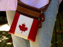 white and red leather purse with the Canadian maple leaf symbol royalty free stock image