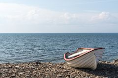 Small rowing boat by the coast Royalty Free Stock Image