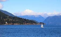 Small white sail yacht sailing in blue sea Royalty Free Stock Image
