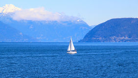 Small white sail yacht sailing in blue sea Royalty Free Stock Photo