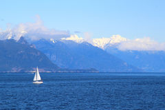 Small white sail yacht sailing in blue sea Royalty Free Stock Images