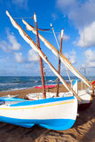 Small white sailing boats lay on the sandy beach Stock Photo