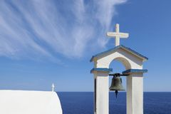 Small white sea side chapel with scenic clouds stock images