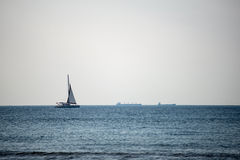 Small white ship in the sea Stock Images