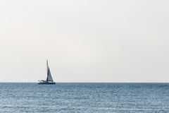 Small white ship in the sea Stock Photos
