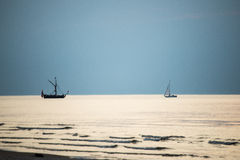 Small white ship in the sea. Small ship in the blue sea Royalty Free Stock Photos