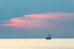 Small white ship in the sea. Small ship in the blue sea Royalty Free Stock Photography