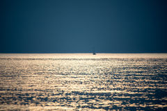 Small white ship in the sea. Small ship in the blue sea Royalty Free Stock Images