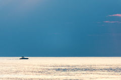 Small white ship in the sea. Small ship in the blue sea Royalty Free Stock Image