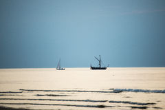Small white ship in the sea. Small ship in the blue sea Stock Photography