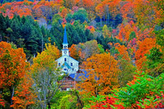 Small white steeple tucked away in the colorful green mountains HDR. Royalty Free Stock Photo