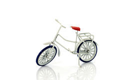 Small white toy bike Stock Photography
