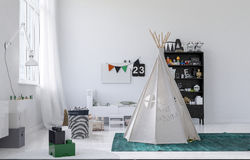 Small white wigwam or tepee in a kids nursery Royalty Free Stock Photo