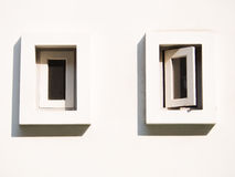 A small white windows. Isolated on a white wall royalty free stock photos