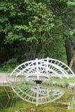 Small white wood bridge in a garden Stock Image