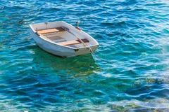 Small white wooden boat on Adriatic Sea Stock Image
