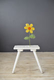 Small white wooden chair with flower  standing on the floor Stock Photo