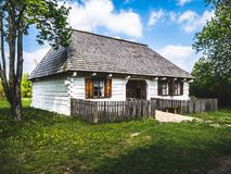 Small white wooden house in the countryside stock image