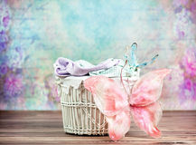 Small wicker basket with colorful background Royalty Free Stock Photo