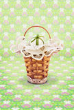 Small wicker basket with Easter eggs Royalty Free Stock Photos