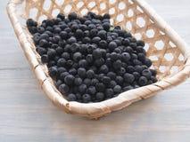 Small wicker basket with fresh wild blueberries Stock Photos