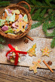 Small wicker basket full of gingerbread for Christmas Stock Photography